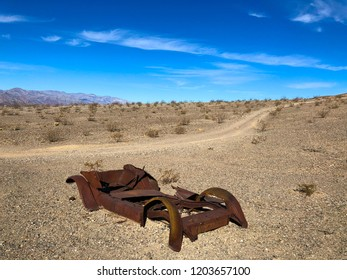 Rusted old car in a desert, details