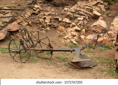 rusted old metal plow. soil treatment tool that works with the help of pets