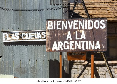 Rusted old retro sign saying welcome to Argentina written in Spanish at old train station at the border of Chile and Argentina near the Aconcagua National Park. Argentina
