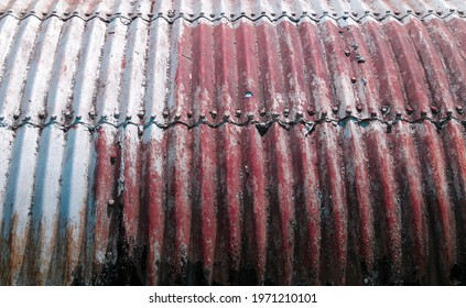 rusted old vintage corrugated quonset hut military building structure farm barn equipment storage shot as an architectural scene in bright sunlight