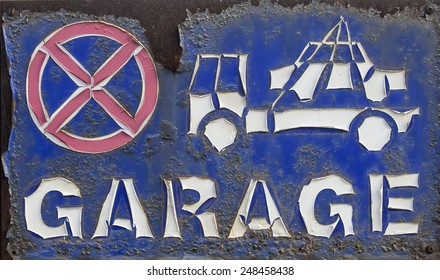 Rusted and peeling - no parking, tow away sign on a garage door