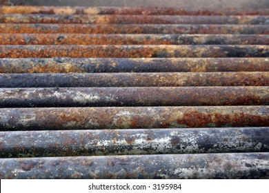Rusted pipes of an old grilling pit photographed in mid afternoon