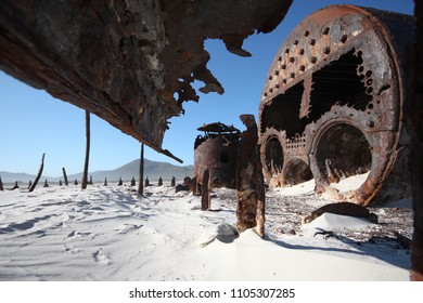The rusted remains of Kakapo Shipwreck on Noordhoek Beach in Cape Town, South Africa
