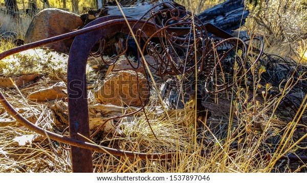 rusted-scrap-metal-on-rocky-600w-1537897
