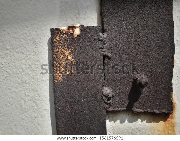 Rusted steel bar On a gray cement background