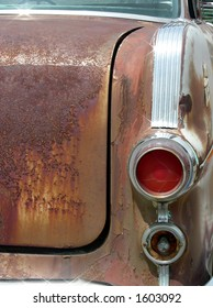 Rusted trunk and tail lights on vintage automobile