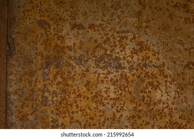 Rusted wall covering at an abandoned old garage.