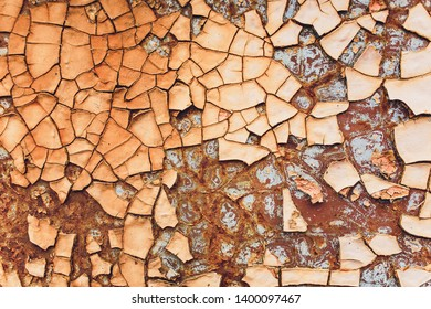 Rusted white painted metal wall. Rusty metal background with streaks of rust. Rust stains. The metal surface rusted spots.metal rust texture background.
