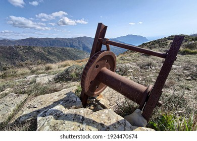 Rusted winch on the top of Fasce Mountain, Genoa Italy