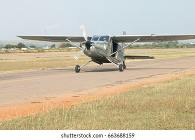 RUSTENBURG, SOUTH AFRICA - April 28, 2017: National Skydiving Championships.  Pilot landing one of two X328 Atlas Angel Turbine specially equipped aircraft for sky divers used at event.
