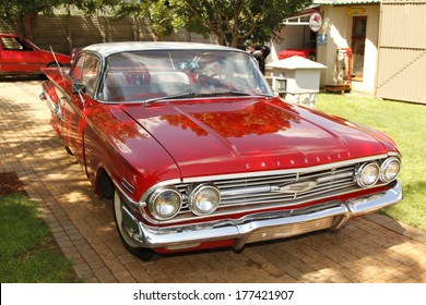 RUSTENBURG, SOUTH AFRICA - FEBRUARY 15:  Red 1960 Chevrolet Impala Bubble Top front view in Private Collection Philip Classic Cars on February 15, 2014 in Rustenburg South Africa.