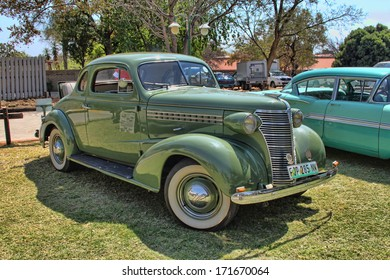 RUSTENBURG, SOUTH AFRICA - SEPTEMBER 9: A green 1936 Ford Two-Door Coupe with Rumble Seat on display at Rusoord old aged home celebration on September 17, 2013 in Rustenburg South Africa.