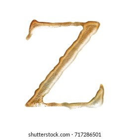 Rustic aged gold style uppercase or capital letter Z in a 3D illustration with a rough tarnished cracked golden color metal surface and jagged font isolated on a white background with clipping path.