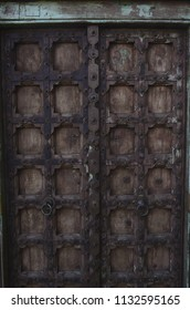 rustic antique wood door with metalwork details Baja, Mexico