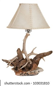 A Rustic antler, rock and driftwood lamp isolated on white background