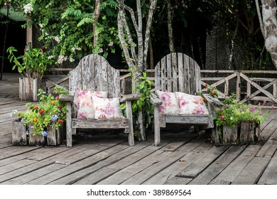 Rustic armchairs with white pillows with flowers