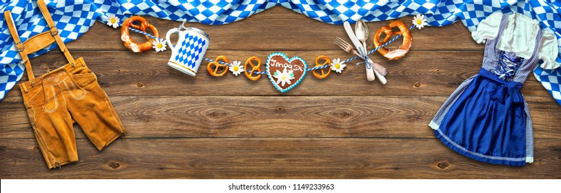Rustic background for Oktoberfest with white and blue fabric, Bavarian clothes, beer stein, pretzel and gingerbread with Letters I Mog Di means I love you
