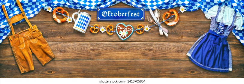 Rustic background for Oktoberfest with white and blue fabric, Bavarian clothes, gingerbread, beer stein and pretzel