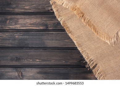 Rustic background with wood and sackcloth