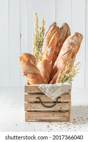 Rustic baguettes baked in bakery. Baguettes from the bakery. Pieces of baguette.