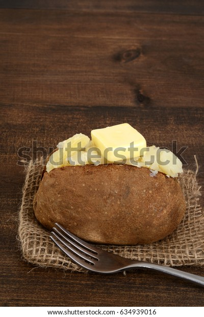 rustic baked potato with butter