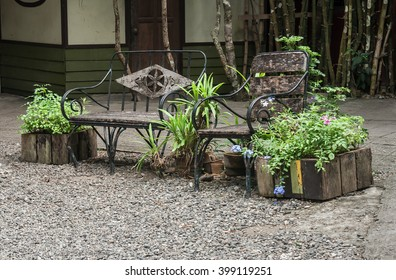 Rustic bench and chair in a garden