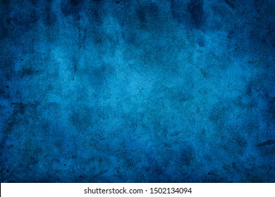 Rustic blue wall background with darker black grungy border and vintage texture design.