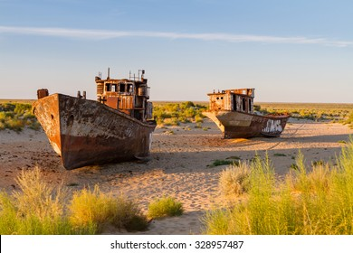 Rustic boats on a ship graveyards on a desert around Moynaq, Muynak or Moynoq - Aral sea or Aral lake - Uzbekistan, Central Asia.