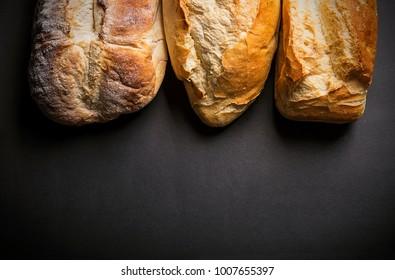 Rustic bread loaf on dark background