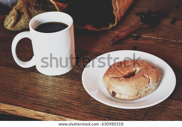 Rustic breakfast, bagel and coffee