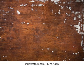 Rustic Brown Wood Background with Wood Grain and Light Blue Paint Spots