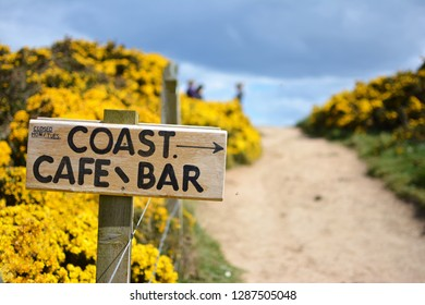Rustic cafe/bar sign on a seaside path in Whitby, Yorkshire.