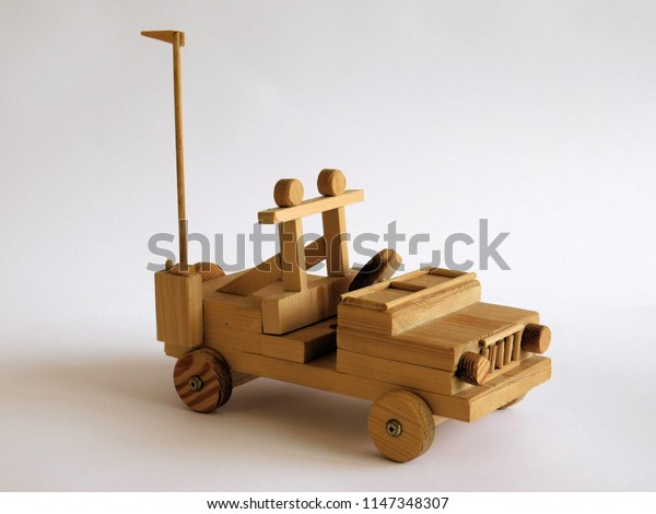rustic car made of wood on the white background