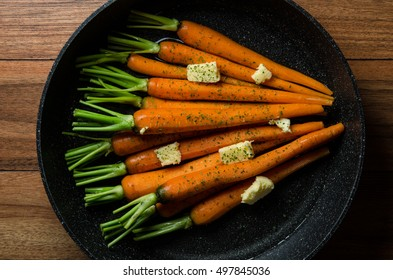 Rustic carrots on wood
