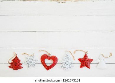 Rustic Christmas decoration and ornament made of metal on white wood background. vintage style, topview.