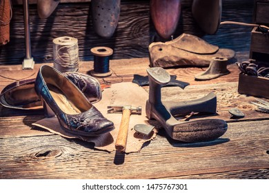 Rustic cobbler workshop with shoes, laces and tools