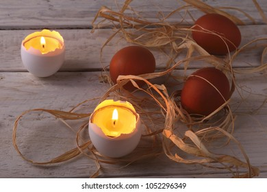 Rustic composition with candles and eggs. Happy easter. Selective focus.
