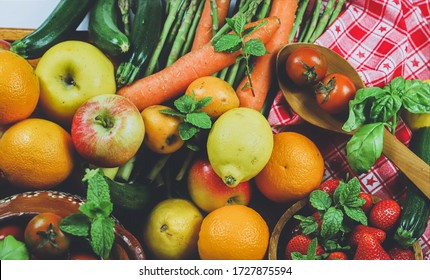 rustic composition of mixed fruits and vegetables viewed from above