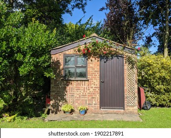 rustic country brick shed on a sunny day