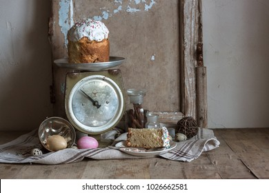 The rustic country still life of old wood frames, painting and quail eggs, scale, glass bottle with cinnamon sticks, easter, feud cloth and bast on the wooden table.Shabby chic still life composition.