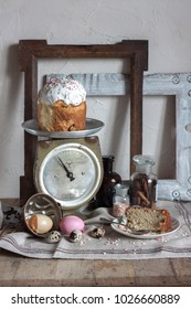 The rustic country still life of scale, old wood frames,  glass bottle with cinnamon sticks, painting and quail eggs,feud cloth and bast on the wooden table. Shabby chic still life composition.