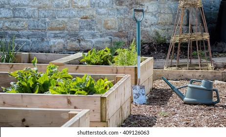 Rustic Country Vegetable & Flower Garden with Raised Beds. Spade & Watering Can