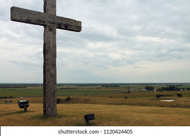 Rustic cross near fields midwest Nebraska country field landscape