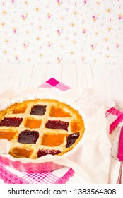 Rustic crostata, an Italian baked tart with 3 type of marmalade. Copy space