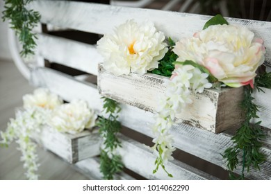 Rustic decor in a spring studio with greenery and flowers