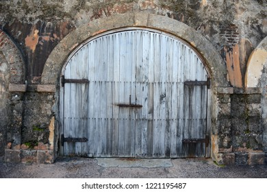Rustic door with arch on top at Old San Juan in Puerto Rico
