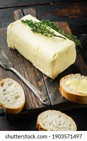 Rustic farmhouse inspired fresh butter, on old dark wooden table background