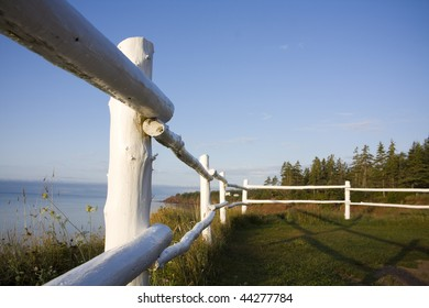 Rustic fence overlooking atlantic ocean in cape bear, PEI