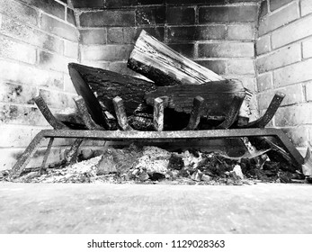 Rustic fireplace with brick walls