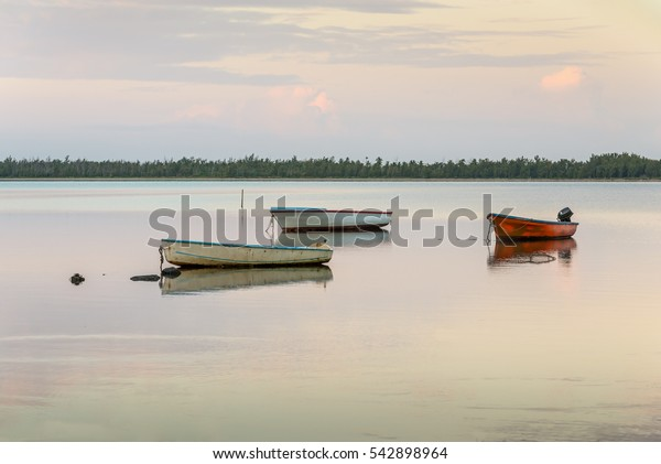 Rustic fishing boats at sunrise. Mauritius island scenery.